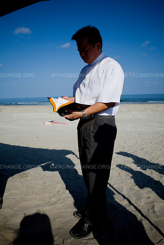 Grand Isle, Louisiana.June 13, 2010..Ecumenical interfaith prayer service as part of community response to the BP Deepwater Horizon oil spill. Father Michael Tran of the local Catholic Church..