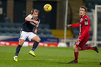 27th March 2021; Dens Park, Dundee, Scotland; Scottish Championship Football, Dundee FC versus Dunfermline; Paul McMullan of Dundee hits a pass as Iain Wilson of Dunfermline Athletic tries in vain to shut him down