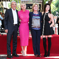 HOLLYWOOD, LOS ANGELES, CA, USA - OCTOBER 29: Gary Carmine Cuoco, Kaley Cuoco, Layne Ann Cuoco, Briana Cuoco at the ceremony honoring Kaley Cuoco with a star in the Hollywood Walk Of Fame on October 29, 2014 in Hollywood, Los Angeles, California, United States. (Photo by Xavier Collin/Celebrity Monitor)