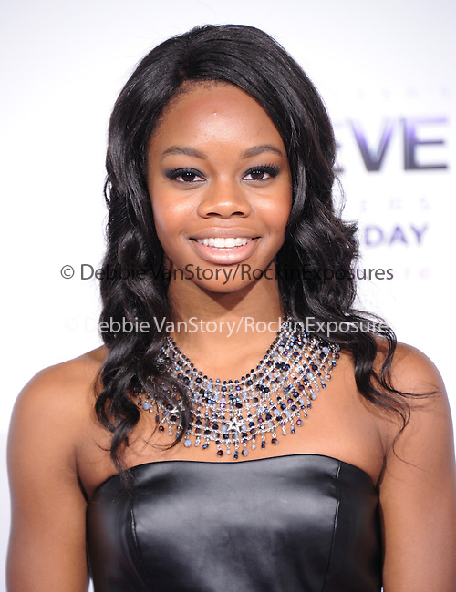 LOS ANGELES, CA - December 18: Gabby Douglas arrives at Justin Bieber`s Believe World Premiere held at The Premiere House at Regal Cinemas L.A. Live in Los Angeles, California on December 18,2013                                                                               © 2013 Hollywood Press Agency