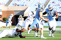CHAPEL HILL, NC - NOVEMBER 14: Dion Bergan Jr. #95 of Wake Forest grabs the jersey of Sam Howell #7 of North Carolina during a game between Wake Forest and North Carolina at Kenan Memorial Stadium on November 14, 2020 in Chapel Hill, North Carolina.