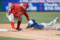 Philadelphia Phillies third baseman Jose Tortolero (33) tags Chris Bec (10) out as he slides into the bag during an Instructional League game against the Toronto Blue Jays on September 23, 2019 at Spectrum Field in Clearwater, Florida.  (Mike Janes/Four Seam Images)
