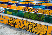 View of hand painted tiles on Selaron's Stairs (Escadaria Selarón), a mosaic staircase made of colorful tiles, in Rio de Janeiro, Brazil, 12 February 2012. World-famous staircase, mostly covered by vibrant yellow, green and blue tiles (inspired by the colors of the Brazilian flag), is the masterpiece of Chilean-born artist Jorge Selarón who considers it as a personal tribute to the Brazilian people. Connecting the neighborhoods of Santa Teresa and Lapa, the stairway is made up of 250 steps and measures 125 meters long. In 1990 Selarón began work on the stairway, creating a constantly evolving piece of art, now adorned with over 2,000 brightly colored tiles collected from over 60 countries. Selarón funds his one man's project through donations and the sale of his black-and-red paintings which mostly depict a pregnant African woman or himself. Living his passion, the eccentric 65-year-old artist claims that this crazy and unique dream will only end on the day of my death.