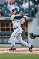 Ryan Brett (4) of the Durham Bulls follows through on his swing against the Charlotte Knights at BB&T BallPark on May 15, 2017 in Charlotte, North Carolina. The Knights defeated the Bulls 6-4.  (Brian Westerholt/Four Seam Images)