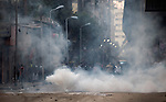Tear gas fills a street in downtown Cairo, Egypt, Jan. 26, 2011. Violent clashes between demonstrators and police continued into a second day, as protesters attempted to build momentum in a movement inspired by the recent Tunisian uprising.