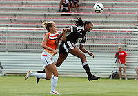 BOYDS, MARYLAND - July 22, 2012:  Tiffany Brown (9) of DC United Women heads the ball away from Paige Lanter (14) of the Charlotte Lady Eagles during the W League Eastern Conference Championship match at Maryland Soccerplex, in Boyds, Maryland on July 22. DC United Women won 3-0.