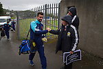 Harestanes AFC v Girvan FC, 15/08/2015. Scottish Cup preliminary round, Duncansfield Park. A club official welcoming the home players outside the main gate before Harestanes AFC take on Girvan FC in a Scottish Cup preliminary round tie, staged at Duncansfield Park, home of Kilsyth Rangers. The home team were the first winners of the Scottish Amateur Cup to be admitted directly into the Scottish Cup in the modern era, whilst the visitors participated as a result of being members of both the Scottish Football Association and the Scottish Junior Football Association. Girvan won the match by 3-0, watched by a crowd of 300, which was moved from Harestanes ground as it did not comply with Scottish Cup standards. Photo by Colin McPherson.