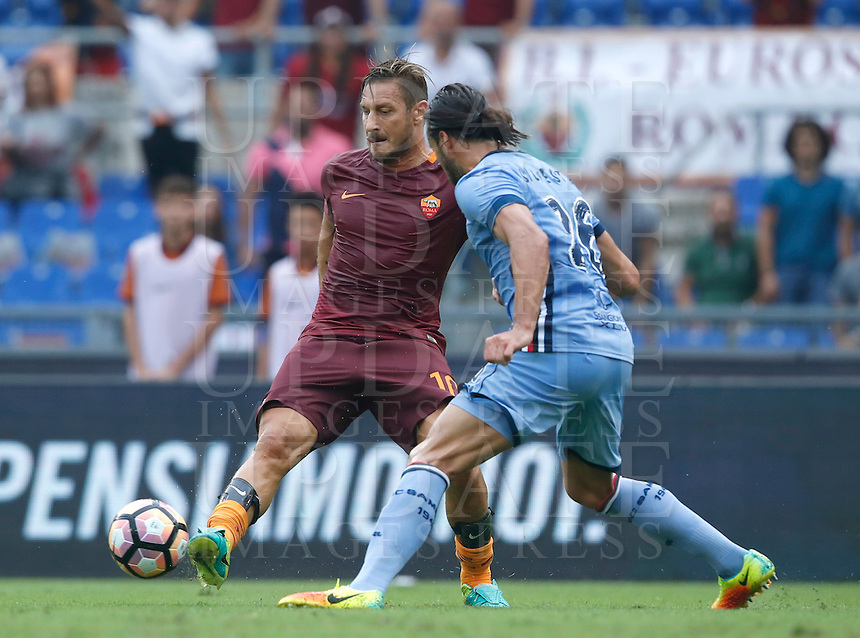 Calcio, Serie A: Roma vs Sampdoria. Roma, stadio Olimpico, 11 settembre 2016.<br /> Roma's Francesco Totti, left, is challenged by Sampdoria's Matias Silvestre during the Italian Serie A football match between Roma and Sampdoria at Rome's Olympic stadium, 11 September 2016. Roma won 3-2.<br /> UPDATE IMAGES PRESS/Isabella Bonotto
