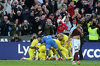 Brentford goalkeeper, David Raya, runs the length of the   pitch to join in the celebrations after Yoane Wissa scores a last minute goal during West Ham United vs Brentford, Premier League Football at The London Stadium on 3rd October 2021