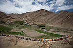 Monks and nuns follow His Holiness the Gyalwang Drukpa, leader of the Buddhist Drukpa Lineage, who led a 400 kilometre walking pilgrimage known as the Pad Yatra , over the Himalaya's from Manali in Himachal Pradesh to Hemis Monastry located 43kms outside Leh in Ladakh. The trek, taking six weeks and taking participants through altitudes as high as 5200 metres, attracted up to 600 followers including nuns , monks and foreigners. The theme was raising awareness of His Holiness' charitable projects including education , environment and cultural preservation of tribal people from the area. The Pad Yatra is a journey to a sacred site and in this case the route ended at Hemis Monastery for the famous two day Hemis Festival featuring ancient dancing and Buddhist rituals drawing crowds of people from Ladakh and around the world.