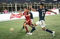 FOXBOROUGH, MA - SEPTEMBER 21: Tate Schmitt #21 of Real Salt Lake advances on the New England goal line with Brandon Bye #15 of New England Revolution and Juan Agudelo #17 of New England Revolution in pursuit during a game between Real Salt Lake and New England Revolution at Gillette Stadium on September 21, 2019 in Foxborough, Massachusetts.