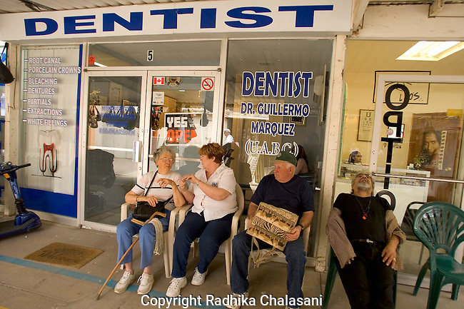 ALGODONES, MEXICO-MARCH 22: Patients wait outside one of the more than 300 dental offices March 22, 2005 in Algodones. Many Americans do not have dental insurance in the U.S. making major dental proceedures extremely expensive especially for those retired on fixed incomes. ©Radhika Chalasani