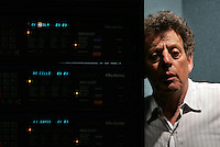 Composer PHILIP GLASS poses in a small studio.  Dunvagen Music Publishers, 632 Broadway, NYC.  Newsday/ARI MINTZ  6/13/2005.