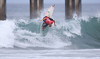 Huntington Beach, CA - Sunday July 30, 2017: Kalani Ball during a Qualifying Series (QS) trials round heat in the 2017 Vans US Open of Surfing on the South side of the Huntington Beach pier.