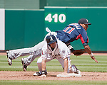 Reno Aces runner Adam Eaton slides hard into Tacoma Rainiers second baseman Leury Bonilla as he turns a double plan in their game played on Monday, May 7, 2012 in Reno, Nevada.