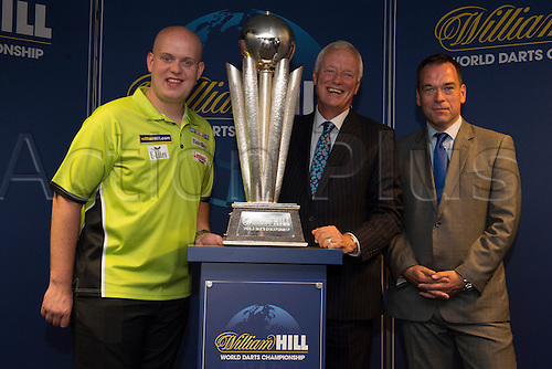 13.06.2014. London, England.  Rileys Sports Bar, Haymarket. The  launch of William Hill's sponsorship as title sponsor of the 2015 World Darts Championship. Reigning World Darts Champion Michael van Gerwen [L], PDC Chairman Barry Hearn [C] and William Hill Chief Marketing Officer Kristof Fahy [R].