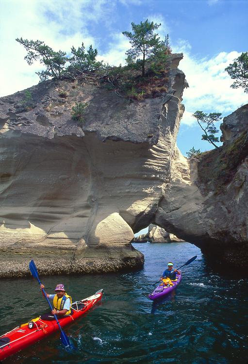 Sea kayaking, Japan, kayakers paddle through sandstone arches, Sendai, Fukushima, Honshu, Japan,