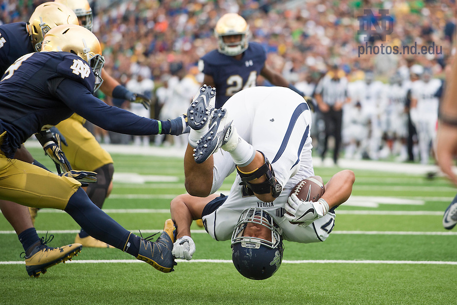 September 10, 2016; Nevada Wolf Pack tight end Jarred Gipson (47) flips as he is tackled by Notre Dame Fighting Irish linebacker Te'von Coney (4) in the second quarter. (Photo by Matt Cashore)