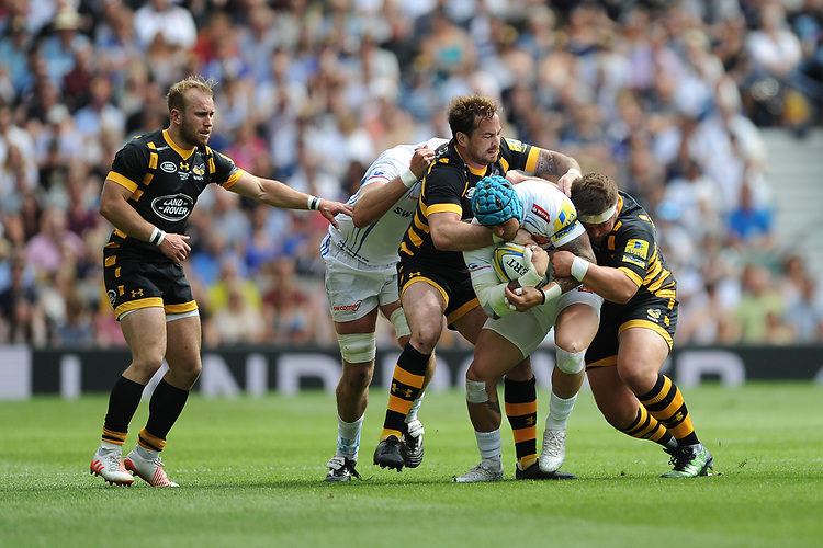 Thomas Waldrom of Exeter Chiefs is tackled by Danny Cipriani and Phil Swainston of Wasps during the Premiership Rugby Final at Twickenham Stadium on Saturday 27th May 2017 (Photo by Rob Munro)