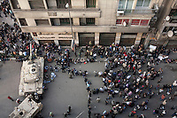 An aerial view of protesters and tanks in Tahrir Square. Continued anti-government protests take place in Cairo calling for President Mubarak to stand down. After dissolving the government, Mubarak still refuses to step down from power.