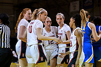 SANTA CRUZ, CA - JANUARY 22: Ashten Prechtel #11, Alyssa Jerome #10, Lexie Hull #12, Lacie Hull #24, Kiana Williams #23 in a quick team huddle during the Stanford Cardinal women's basketball game vs the UCLA Bruins at Kaiser Arena on January 22, 2021 in Santa Cruz, California.