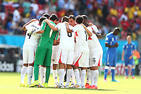 Costa Rica huddle together before the start of the second half