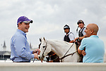 LOUISVILLE, KENTUCKY - APRIL 30: Trainer Mark E.Casse (R) talks with his son and assistant trainer Norm Casse during morning workouts at Churchill Downs on April 30, 2017 in Louisville, Kentucky. (Photo by Jon Durr/Eclipse Sportswire/Getty Images)
