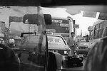 The Peoples Republic of China. Shanghai. A traffic-jam seen from inside a taxi. A short journey in Shanghai costs 10RMB. Taxi drivers can be both friendly and helpful. However it is unusual to find one who understands English so it is very useful to have written down in Chinese where you are going and your return address.  Maps in English and Chinese are also handy.