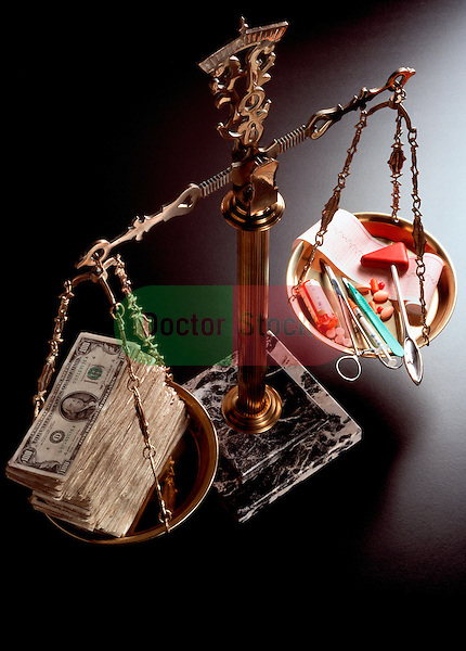 balance scale with pile of money on one side and medical tools