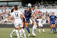 CARY, NC - SEPTEMBER 12: Abby Erceg #6 of the North Carolina Courage and Christine Sinclair #12 of the Portland Thorns FC challenge for a header during a game between Portland Thorns FC and North Carolina Courage at Sahlen's Stadium at WakeMed Soccer Park on September 12, 2021 in Cary, North Carolina.