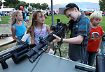 From left, Kendall Scott, Alyssa Birri, both 9, Anthony Singh, 11, and Bodie Norlock, 7, check out the SWAT booth at the 11th annual National Night Out hosted by the Carson City Sheriff's Office in Carson City, Nev., on Tuesday, Aug. 6, 2013. <br /> Photo by Cathleen Allison