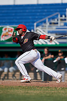 Batavia Muckdogs right fielder Albert Guaimaro (13) follows through on a swing during a game against the West Virginia Black Bears on July 1, 2018 at Dwyer Stadium in Batavia, New York.  Batavia defeated West Virginia 8-4.  (Mike Janes/Four Seam Images)
