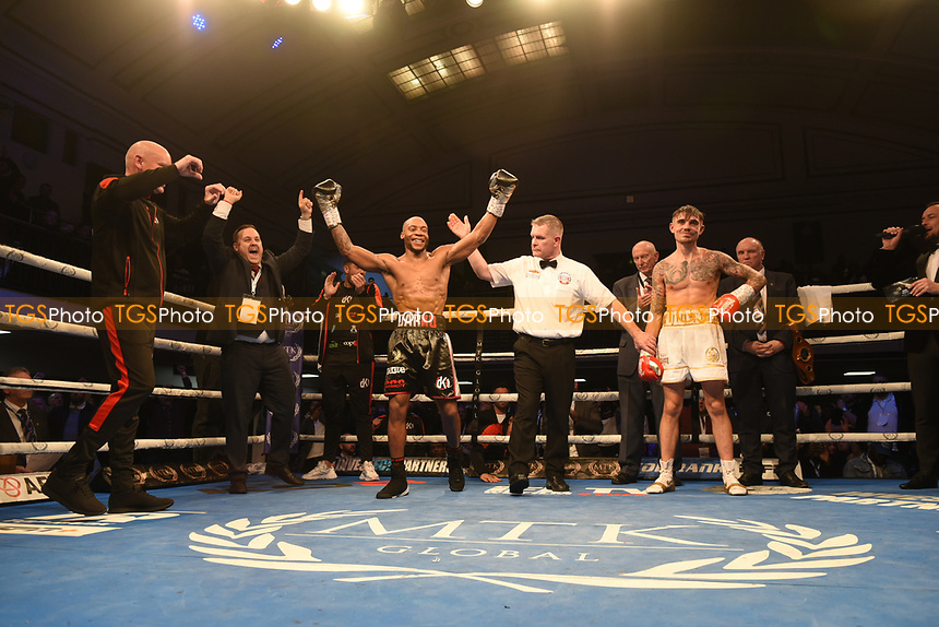 MTK Global Boxing Promoter Lee Eaton (2nd L) celebrates with Daniel Egbunike during a Boxing Show at York Hall on 9th November 2019