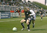 Rebecca Moros #19 of the Washington Freedom is held back by Chioma Igwe #12 of the Chicago Red Stars during a WPS match at Maryland Soccerplex on April 11 2009, in Boyd's, Maryland. The game ended in a 1-1 tie