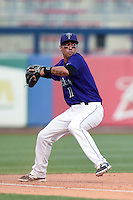Tulsa Drillers third baseman Joey Wong (1) throws to first after making a diving stop during the second game of a doubleheader against the Frisco Rough Riders on May 29, 2014 at ONEOK Field in Tulsa, Oklahoma.  Frisco defeated Tulsa 3-2.  (Mike Janes/Four Seam Images)
