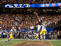 Marcus Davis of Virginia Tech caught a touchdown pass against Michigan during Sugar Bowl game at Mercedes-Benz SuperDome in New Orleans, Louisiana on January 3rd, 2012.   Michigan defeated Virginia Tech, 23-20 in first overtime.