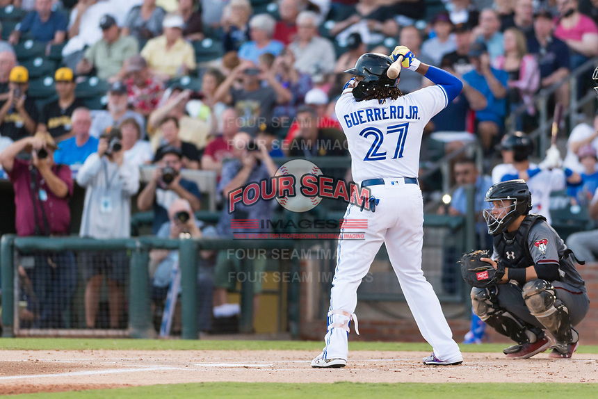 AFL West third baseman Vladimir Guerrero Jr. (27), of the Surprise Saguaros and Toronto Blue Jays organization, at bat in front of catcher Daulton Varsho (8) during the Arizona Fall League Fall Stars game at Surprise Stadium on November 3, 2018 in Surprise, Arizona. The AFL West defeated the AFL East 7-6 . (Zachary Lucy/Four Seam Images)