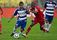 24 July 2010:   FC Dallas midfielder/forward David Ferreira #10 and Toronto FC midfielder Amadou Sanyang #22 in action during a game between FC Dallas and Toronto FC at BMO Field in Toronto..The final score was a 1-1 draw...