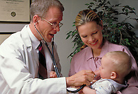 Mom and Baby at the doctor's office. Male doctor examines infant with stethoscope, as smiling mother looks on. medical care, health, occupations. Kirsten and Cameron Burke, Bob Robbins.