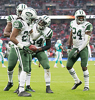 04.10.2015. Wembley Stadium, London, England. NFL International Series. Miami Dolphins versus New York Jets. New York Jets Cornerback Marcus Williams celebrates with team mates after hebintercepted the ball thrown by Miami Dolphins Quarterback Ryan Tannehill in the End Zone.