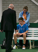 Rotterdam, The Netherlands, 15.03.2014. NOJK 14 and 18 years ,National Indoor Juniors Championships of 2014, Jasper Baggerman (NED) gets a medical treatment<br /> Photo:Tennisimages/Henk Koster