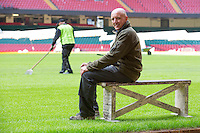 Lee Evans, Head Groundsman at the Millennium Stadium poses for photographs on a bench which now bears the words Millennium Stadium, handwritten by the Desso workers alongside the names of other major sports stadiums that have called in the Desso experts, including Wembley Stadium, Twickenham and the home of Real Madrid. Cardiff, United Kingdom. 7th October 2014