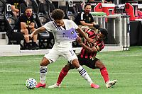 ATLANTA, GA - AUGUST 29: Junior Urso #11 of Orlando City shields the ball from Mo Adams #29 of Atlanta United during a game between Orlando City SC and Atlanta United FC at Marecedes-Benz Stadium on August 29, 2020 in Atlanta, Georgia.