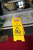 Cleaning in Progress, health and safety sign in Islington Town Hall during the early morning cleaning shift.