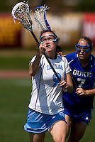 Jenn Russell (9) of North Carolina takes control of the ball in front of Christie Kaestner (7) of Duke during the ACC women's lacrosse tournament semifinals in College Park, MD.  North Carolina defeated Duke, 14-4.