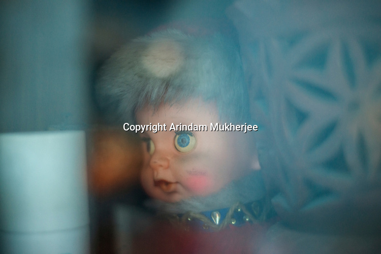 Guddu, the favourite doll of Dipmalya( Diya). He used to play with Guddu only after he was physically abused by one of his family members. Kolkata, India. Arindam Mukherjee