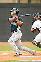 Matt Browning #4 of the Pulaski Mariners follows through on his swing against the Bristol White Sox at Boyce Cox Field August 28, 2010, in Bristol, Tennessee.  Photo by Brian Westerholt / Four Seam Images