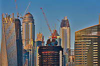 Skyscrapers and cranes close-up on the endless construction in Dubai, United Arab Emirates, Asia