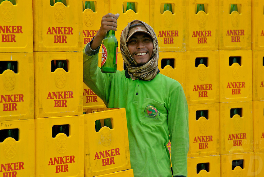 Indonesian harbor worker unloading the local beer in the harbor of Jakarta  Indonesia