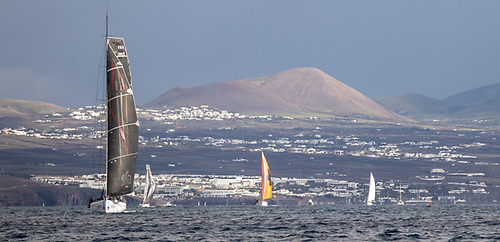 The dramatic volcanic mountains of Lanzarote make an impressive backdrop as the RORC Transatlantic Race fleet head for Grenada